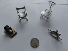 Lot with silver miniatures: dagobert chair, table and chair, rocking horse, sledge, Netherlands, 20th century