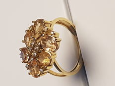 Gold ring with 6 imperial topazes and diamonds