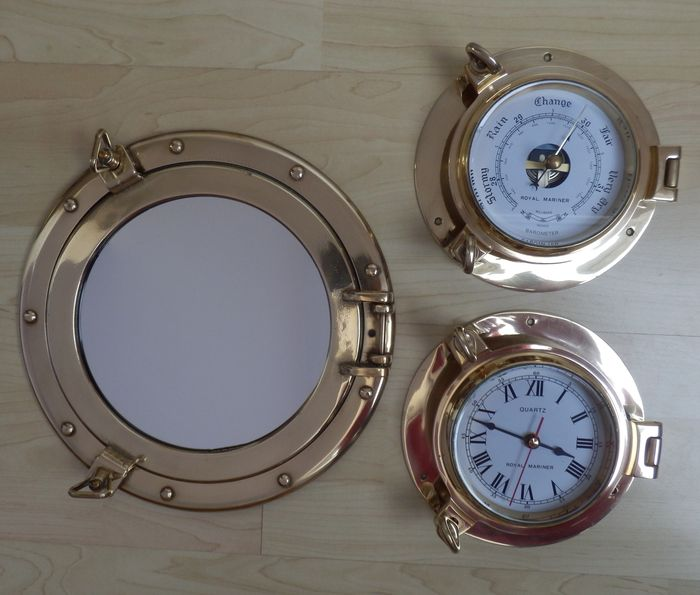 Brass ship's clock, barometer and porthole mirror