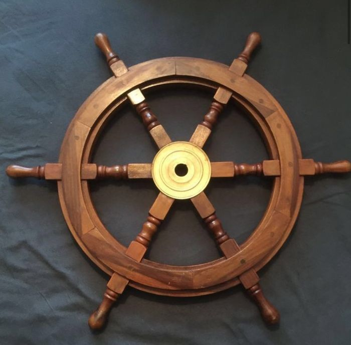 Large wooden boat steering wheel