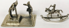 Two silver miniatures: man in gallows and rocking horse, Netherlands, ca. 1970