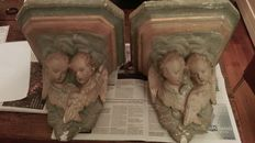 Antique set of 2 plastered hand painted consoles with Angels. Estimated age early 19th - late 18th century