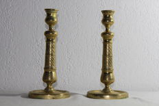 Pair of embossed bronze candleholders - 19th century