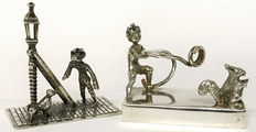 Silver miniature boy with squirrel ca. 1970 and lantern lighter 1979