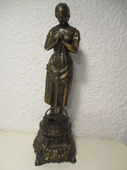 Bronze statue of a rural woman praying