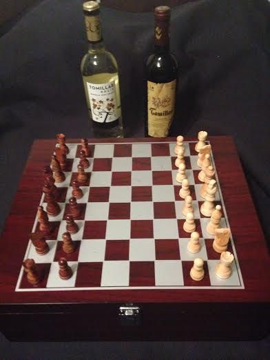 Chess set in wood case with accessories and La Mancha wine