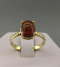 14kt Gold ring with 4.27 ct spessartite garnet  with 10 diamonds - size 18.0