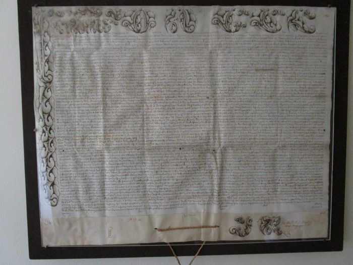 Papal Bul calligraphed hand writing on parchment of Pope Clemens XIII (1693-1769) with fabric cord and lead seal undamaged mounted on a wooden frame behind plexiglass ca. 1760