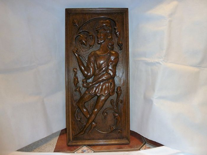 Carved oak panel depicting a man th century catawiki