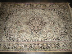 Hand-knotted Indian silk rug