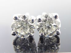 White gold solitaire ear studs set with two brilliant cut diamonds, 0.96 ct in total