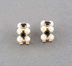 Yellow gold earrings with sapphires and pearls.