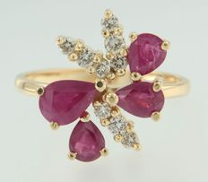 18 kt yellow gold ring set with 4 pear cut rubies and 9 diamonds; ring size 17.25 (54)
