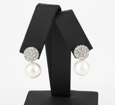 White gold circular stud earrings with brilliant cut diamonds and 10.75 mm Australian South Sea pearls