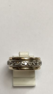 18 kt bi-colour gold ring with a rotatable white gold ring, fully set with diamonds – made by a goldsmith