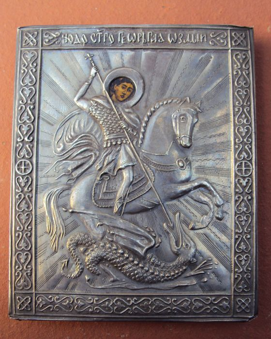 "Russian icon, ""St George Slaying the Dragon"" with embossed silver riza, 1890"