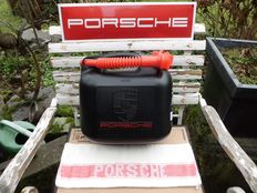 3 Porsche automobilia: Porsche gasoline canisters, Porsche sign and Porsche workshop cloth