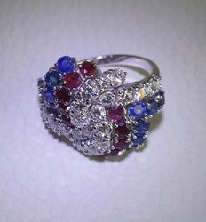 Wonderful cocktail ring with 1.50 ct diamonds, rubies, and sapphires.