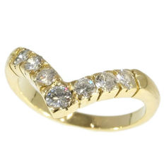Gold friendship or engagement ring set with brilliant cut diamonds