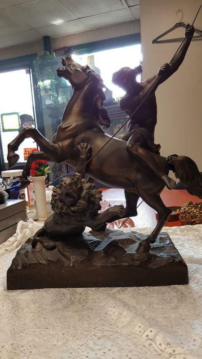 A zamac sculpture depicting a hunting scene with a lion, 20th century
