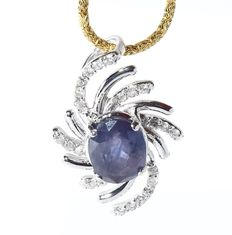 White Gold, GRS Certified designer 5.55. ct. unheated Blue Sapphire ( Kashmir ) and 0.74 ct. diamond pendant