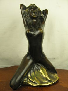Sculpture; barely clothed posing girl - 2nd half of the 20th century
