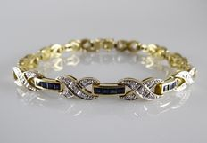 18 kt yellow gold bracelet with 38 blue sapphires and 50 brilliant cut diamonds, 0.50 ct.