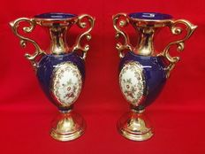 Pair of gold enamelled ceramic vases with floral motifs, second half of the 20th century, Italy