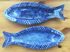 Two Delft style herring dishes, marked E..K