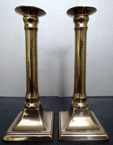 A bronze pair of George III candlesticks - England 1785-90, published