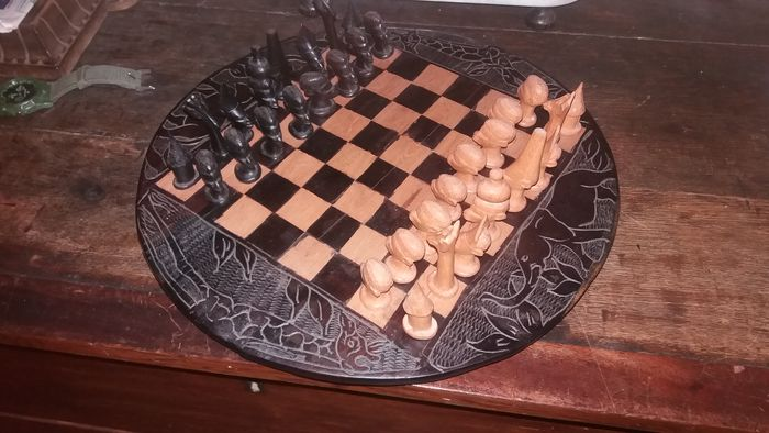 Beautifully carved and inlaid old chess set from Africa