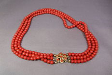 Precious coral necklace with 3 strands and gold clasp.