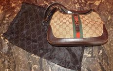 Gucci handbag in canvas and brown leather, with the GC logo (Jackie Kennedy adored this bag)