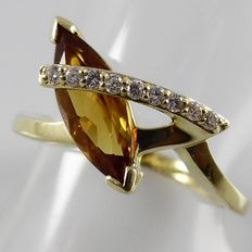 18k yellow gold ring with a citrine and 9 brilliant cut diamonds