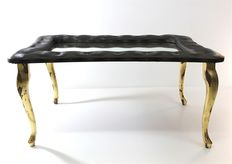 Decorated wooden table with gold leaf legs, covered with brown eco-leather, with a nestled mirrored glass decorated with Swarovski crystals.