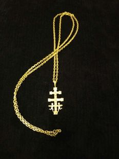 Gold necklace and cross