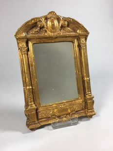 Mirror in gold-plated composite frame in Baroque style, second half of 20th century