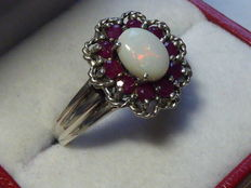 Silver ring with full opal and rubies
