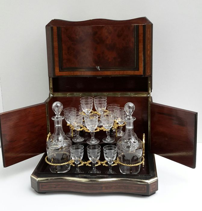 A Napoleon III Cave Liqueur - ashwood, rosewood, ebony and bois noirci with mother of pearl and brass inlay - lock with signature Diehl à Paris - France - third quarter of 19th century