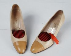 Women's two-tone vintage Chanel court shoes.