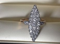 Antique 18 kt marquise ring set with natural diamonds.