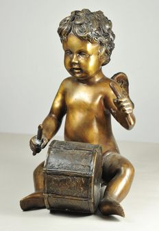 Putto playing the drum
