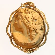 Victorian gold brooch with high relief lava cameo representing Bacchus surrounded by two snakes, ca. 1880