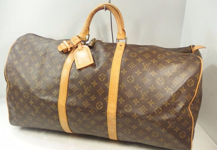 352611845c Louis Vuitton – Keepall 60 Travel bag with tag/name and Handle Holder