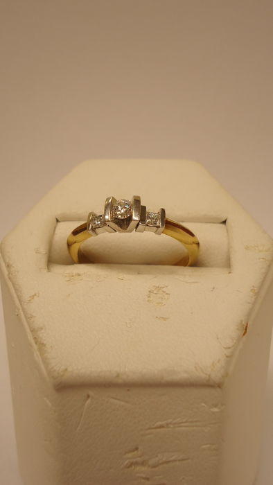 Yellow gold ring set with 3 brilliant cut diamonds of  0.20 ct in total