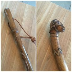 Two popular art carved walking sticks (with snake/with army officer) - ca. 1920