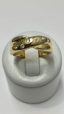 Gold and diamond ring in the shape of a knot.