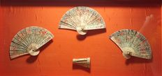 Collection of three Chinese hand fans and hand fan support, in polychromed bone with carvings and openwork