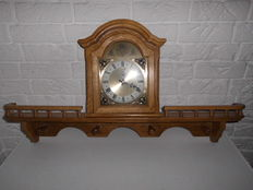 Beautiful white oak clock of Meister Anker, with regal to put two ornamental plates