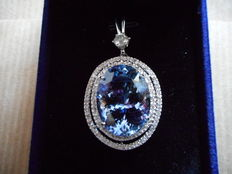 18 kt gold pendant with 28.61 ct tanzanite (GRS certified), 0.65 ct solitaire diamond (IGL certified) and 0.64 ct small diamonds